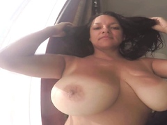 milf-monica-mendez-flashes-her-big-boobs-while-in-the-beach